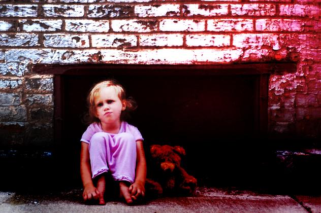 Grumpy Little Girl on Sidewalk with Teddy Bear